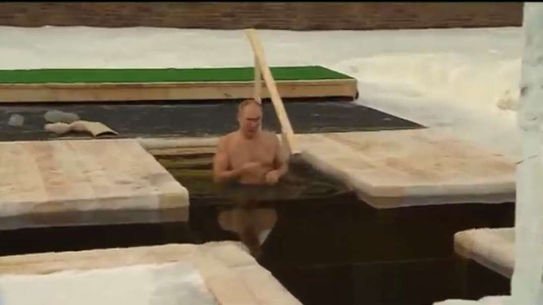 Putin takes traditional Epiphany dip in icy waters