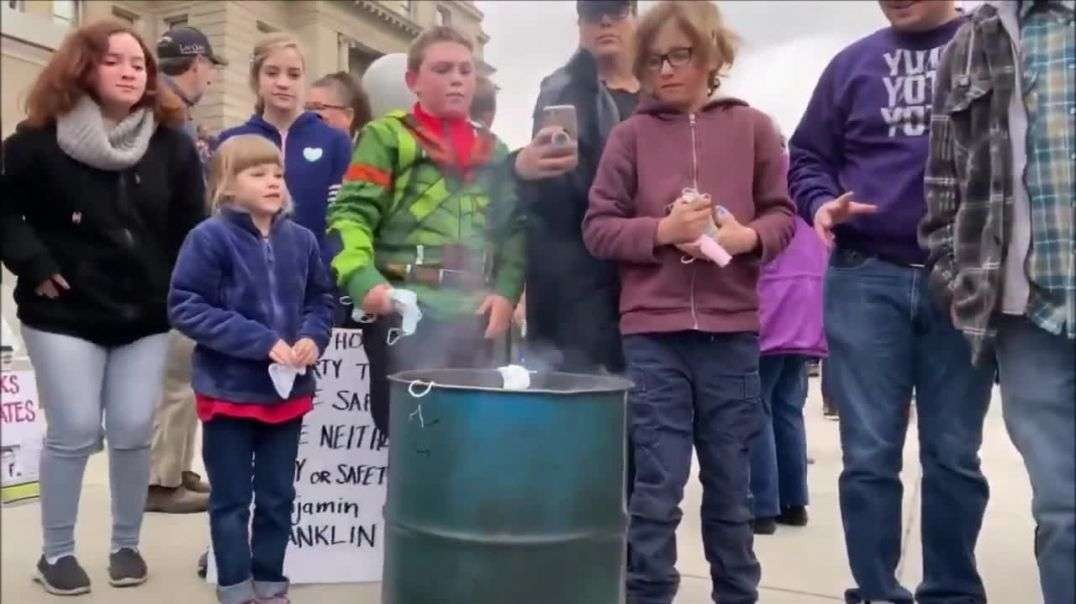 Children burn masks at Idaho State Capitol